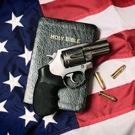 Gun and Bible on American Flag