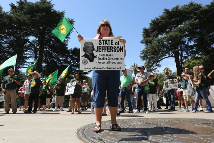Laura Reeg, of Yuba City, joined dozens of others from several rural counties in support of creating the the state of Jefferson, at a Capitol  the in Sacramento, Calif., Thursday, Aug. 28, 2014.