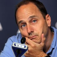 NEW YORK, NY - JULY 08: General manager Brian Cashman of the New York Yankees speaks to the media after the game against the Tampa Bay Rays was postponed due to rain on July 8, 2011 at Yankee Stadium in the Bronx borough of New York City. (Photo by Jim McIsaac/Getty Images)