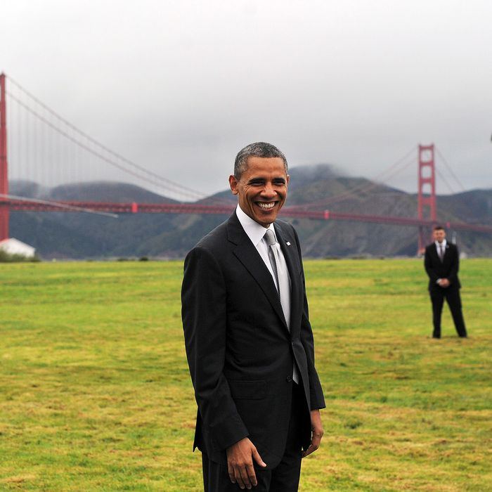 US President Barack Obama smiles before boarding Marine One helicopter from a field overlooking the iconic golden gate bridge in San Francisco, California, on April 4, 2013. Obama is in California to attend two DCCC fund rising events.