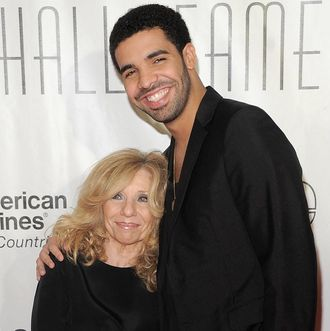 Rapper Drake (R) and Sandi Graham attend the Songwriters Hall of Fame 42nd Annual Induction and Awards at The New York Marriott Marquis Hotel - Shubert Alley on June 16, 2011.