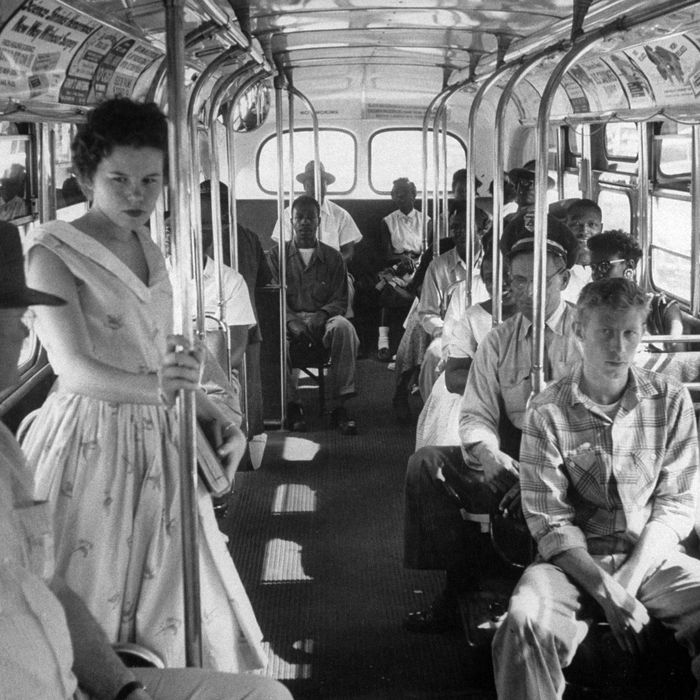 African American citizens sitting in the rear of the bus in compliance with South Carolina segregation law.