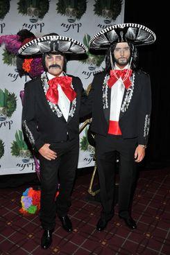 Michael Kors and his husband.
