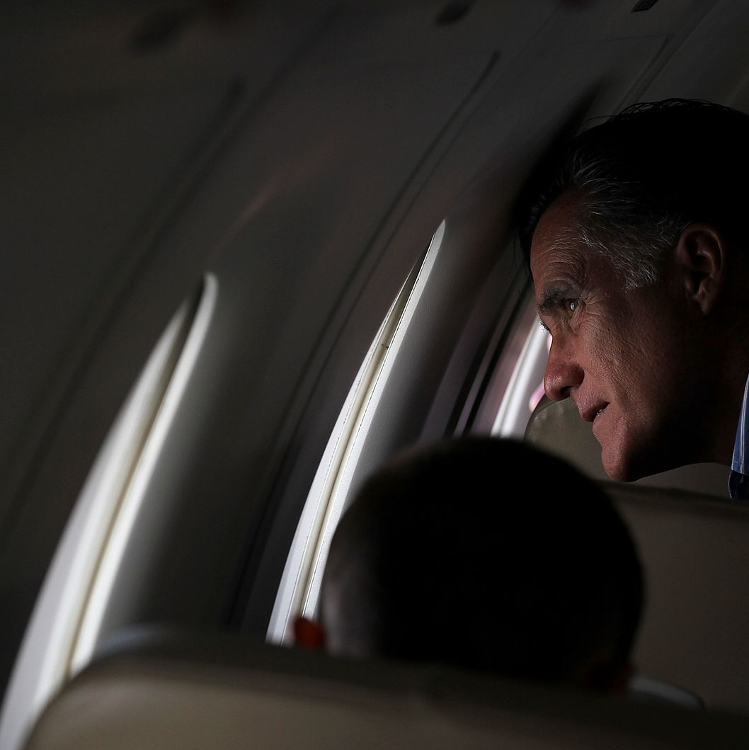 Republican presidential candidate, former Massachusetts Gov. Mitt Romney looks out the window of his campaign plane trying to locate his house after taking off from San Diego International Airport enroute to Colorado on May 28, 2012. Romney spoke at a Memorial Day tribute with U.S. Sen John McCain before heading to Colorado.