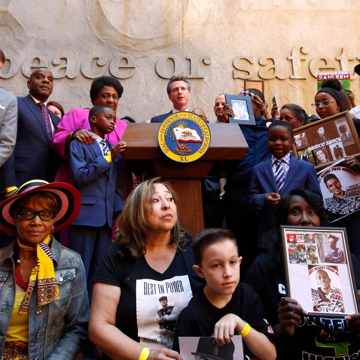 Supporters of a bill limiting the police use of deadly force surround Governor Gavin Newsom, center, during a signing ceremony in Sacramento, California.