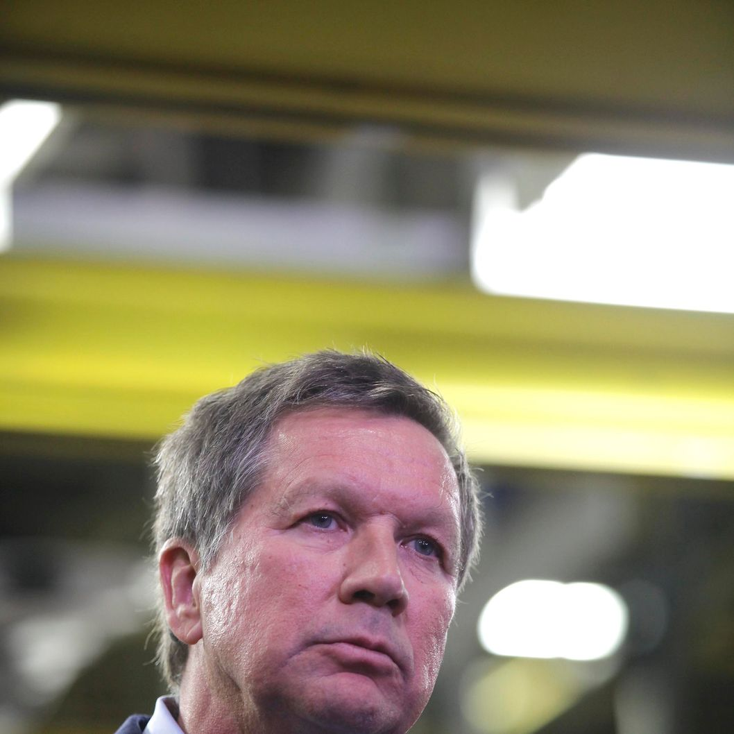 TOLEDO, OH - NOVEMBER 16:  Ohio Gov. John Kasich listens to a speaker at the Toledo Assembly Complex on November 16, 2011 in Toledo, Ohio. Chrysler Group LLC says it will add 1,100 jobs at the Toledo, Ohio assembly complex along with a new body shop and quality center as part of an overall $1.7 billion investment to build a new generation of Jeep sport utility vehicles.  (Photo by J.D. Pooley/Getty Images)