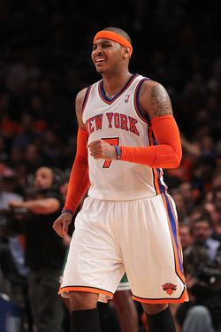 NEW YORK, NY - APRIL 22:  Carmelo Anthony #7 of the New York Knicks reacts against the Boston Celtics in Game Three of the Eastern Conference Quarterfinals in the 2011 NBA Playoffs on April 22, 2011 at Madison Square Garden in New York City. The Celtics won 1113-96. NOTE TO USER: User expressly acknowledges and agrees that, by downloading and or using this photograph, User is consenting to the terms and conditions of the Getty Images License Agreement.  (Photo by Nick Laham/Getty Images)
