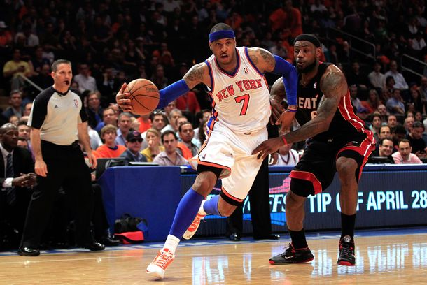 NEW YORK, NY - APRIL 15: (L) Carmelo Anthony #7 of the New York Knicks drives against (R) LeBron James #6 of the Miami Heat at Madison Square Garden on April 15, 2012 in New York City. NOTE TO USER: User expressly acknowledges and agrees that, by downloading and/or using this Photograph, user is consenting to the terms and conditions of the Getty Images License Agreement.  (Photo by Chris Trotman/Getty Images)