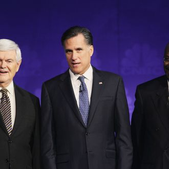 Former speaker of the house Newt Gingrich, former massachusetts Gov. Mitt Romney prior to a debate hosted by CNBC and the Michigan Republican Party at Oakland University on November 9, 2011.
