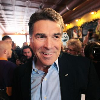 CHEROKEE, IA - DECEMBER 16: Republican presidential candidate Texas Governor Rick Perry arrives at the Copper Cup coffee shop for a campaign stop on December 16, 2011 in Cherokee, Iowa. Perry and the other GOP contenders are in the final stretch of campaigning in Iowa, where the caucus on January 3, 2012 is the first test the candidates must face to become the Republican presidential nominee. (Photo by Scott Olson/Getty Images)