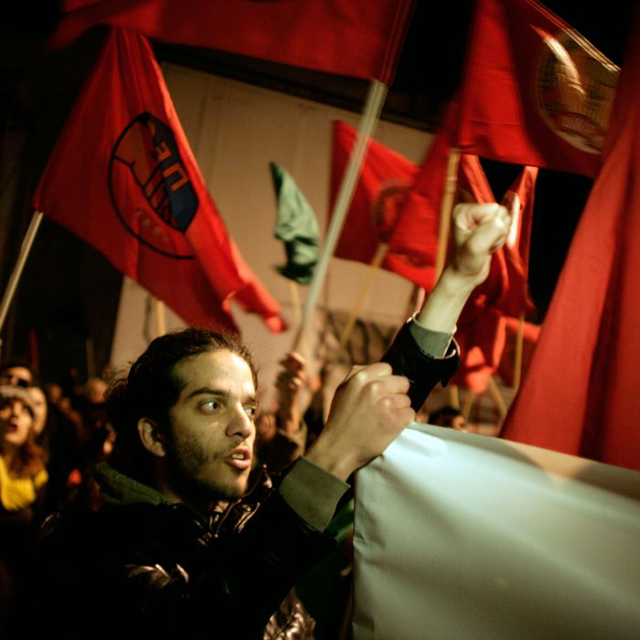 Protestors shout slogans against EU at protest outside a Eurogroup meeting at the European Council building on March 24, 2013 in Nicosia, Cyprus. Talks between the the International Monetary Fund (IMF) and European Union (EU) continue as the country seeks to agree terms to a bailout for its ailing banking sector. Failure to do so is seen as exposing the country to having to leave the eurozone.
