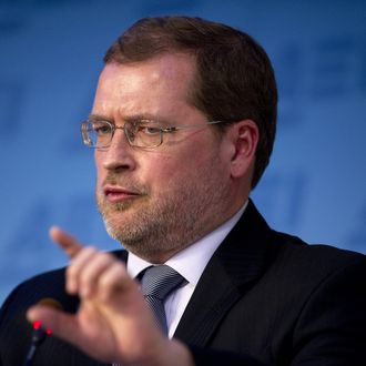 Founder of Americans for Tax Reform Grover Norquist participates in a debate at American Enterprise Institute in Washington, DC, November 29, 2011. AFP PHOTO/Jim WATSON (Photo credit should read JIM WATSON/AFP/Getty Images)