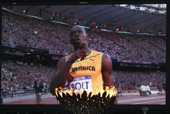 LONDON, ENGLAND - AUGUST 08:  The Olympic Cauldron burns as Usain Bolt of Jamaica is seen afer competing  in the Men's 200m Semifinals on Day 12 of the London 2012 Olympic Games at Olympic Stadium on August 8, 2012 in London, England.  (Photo by Julian Finney/Getty Images)