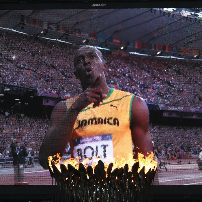 The Olympic Cauldron burns as Usain Bolt of Jamaica is seen afer competing in the Men's 200m Semifinals on Day 12 of the London 2012 Olympic Games at Olympic Stadium on August 8, 2012 in London, England.