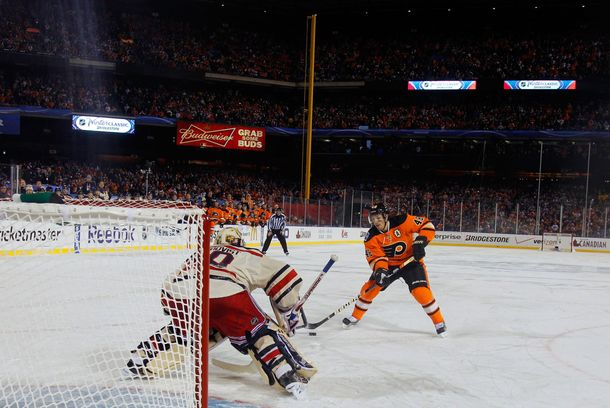 Henrik Lundqvist #30 of the New York Rangers makes a save on a penalty shot by Danny Briere #48 of the Philadelphia Flyers late in the third period during the 2012 Bridgestone NHL Winter Classic at Citizens Bank Park on January 2, 2012 in Philadelphia, Pennsylvania.