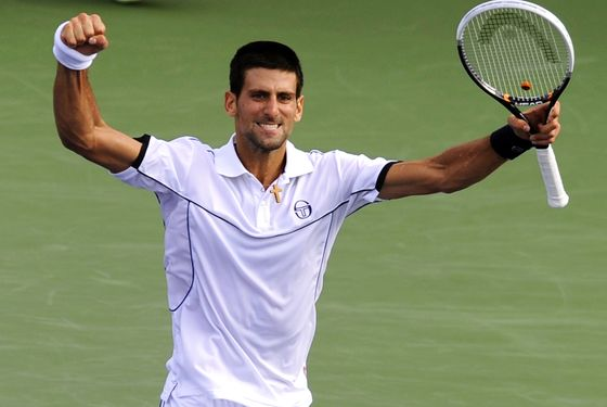 Novak Djokovic of Serbia celebrates after winning the first set against Alexandr Dolgopolov of Ukraine during their Men's 2011 US Open fourth round match at the USTA Billie Jean King National Tennis Center in New York September 5, 2011.     AFP PHOTO/TIMOTHY A. CLARY (Photo credit should read TIMOTHY A. CLARY/AFP/Getty Images)