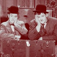 1932:  Stan Laurel (1890 - 1965) and Oliver Hardy (1892 - 1957) in a scene from 'Pack Up Your Troubles', directed by George Marshall and Ray McCarey.  (Photo via John Kobal Foundation/Getty Images)