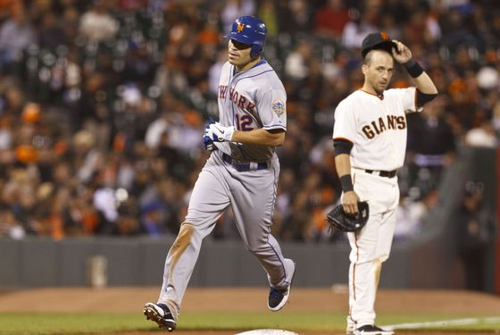 Scott Hairston #12 of the New York Mets rounds the bases after hitting a home run against the San Francisco Giants during the tenth inning at AT&T Park on July 30, 2012 in San Francisco, California.
