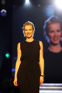 Czech model Eva Herzigova walks the runway during the 2012 Fashion For Kids - New Begining charity fashion show in aid of the Tereza Maxova Foundation at the Municipal House on November 28, 2012 in Prague, Czech Republic.