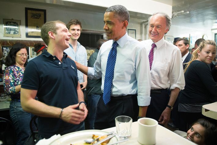 US President Barack Obama (C) talks with Benjamin Gay (L) during a surprise visit to Charlie's Sandwich Shoppe in Boston, MA, June 12, 2013, with US Congressman Ed Markey (R).