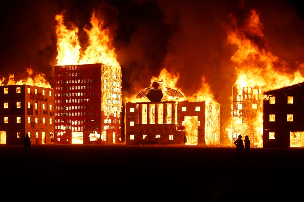 "A multi-building art installation titled ""Burn Wall Street"" is seen during the Burning Man 2012 ""Fertility 2.0"" arts and music festival in the Black Rock Desert of Nevada, September 2, 2012. More than 60,000 people from all over the world have gathered at the sold out festival, which is celebrating its 26th year, to spend a week in the remote desert cut off from much of the outside world to experience art, music and the unique community that develops."