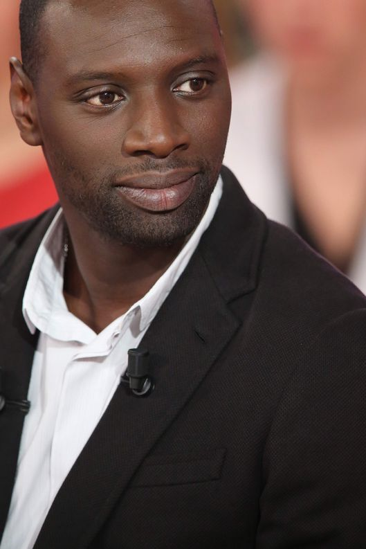 "French actor Omar Sy is pictured as he takes part in the TV show ""Vivement Dimanche"" on December 5, 2012 on a set of French TV France 2 in Paris. AFP PHOTO THOMAS SAMSON        (Photo credit should read THOMAS SAMSON/AFP/Getty Images)"