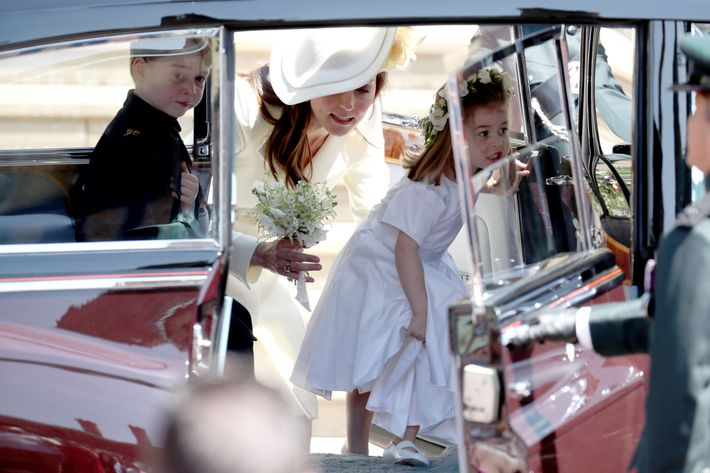 Prince George, Kate Middleton, and Princess Charlotte arriving at the royal wedding.