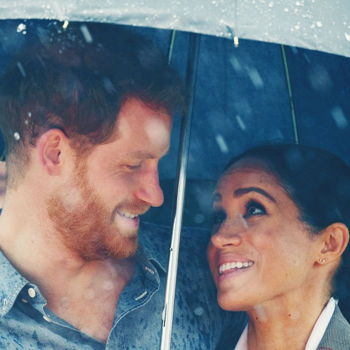 Meghan Markle and Prince Harry under an umbrella in Australia.