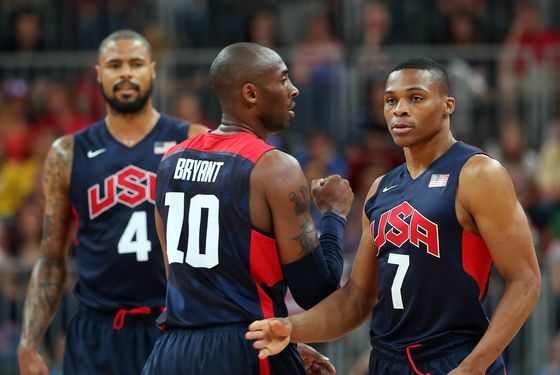 LONDON, ENGLAND - AUGUST 04:  Russell Westbrook #7 of United States talks with Kobe Bryant #10 during the Men's Basketball Preliminary Round match on Day 8 of the London 2012 Olympic Games at the Basketball Arena on August 4, 2012 in London, England.  (Photo by Christian Petersen/Getty Images)