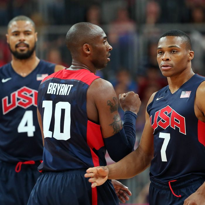 Russell Westbrook #7 of United States talks with Kobe Bryant #10 during the Men's Basketball Preliminary Round match on Day 8 of the London 2012 Olympic Games at the Basketball Arena on August 4, 2012 in London, England.