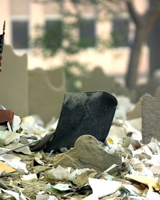 A lone American flag flies among debris in a graveyard in lower Manhattan near the wreckage of the World Trade Center September 13, 2001 in New York City. Rescue efforts continued two days after two airplanes slammed into the twin towers in an alleged terrorist attack, levelling them.