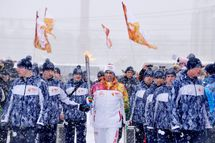 A torchbearer carries an Olympic torch during the Sochi 2014 Winter Olympic torch relay in the southern Russian city of Stavropol, on January 23, 2014.