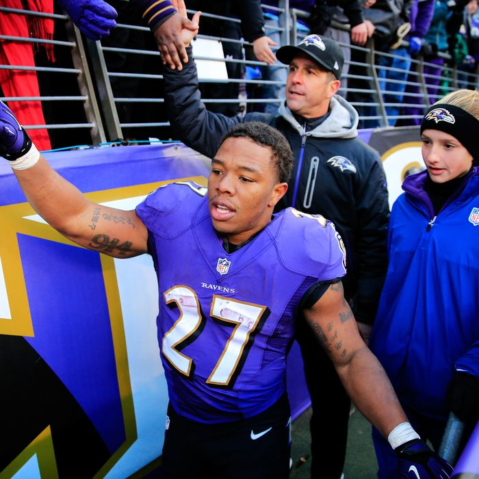 BALTIMORE, MD - NOVEMBER 24: Ray Rice #27 and head coach John Harbaugh of the Baltimore Ravens walk off the field with his daughter Alison following the Ravens 19-3 win over the New York Jets at M&T Bank Stadium on November 24, 2013 in Baltimore, Maryland. (Photo by Rob Carr/Getty Images)