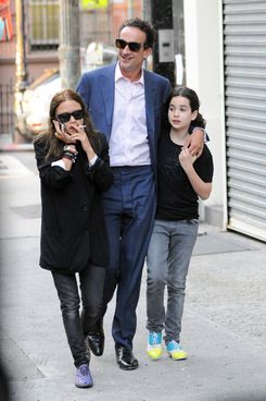 Mary-Kate Olsen, 26, is seen with her new boyfriend, Olivier Sarkozy, 42, the half brother of former French President Nicolas Sarkozy in New York City. The couple was joined by Sarkozy's daughter as they headed out to dinner in the West Village.