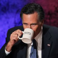 HANOVER, NH - OCTOBER 11:  Former Massachusetts Gov. Mitt Romney takes a drink during a break in the Republican Presidential debate hosted by Bloomberg and the Washington Post on October 11, 2011 at Dartmouth College in Hanover, New Hampshire. Eight GOP candidates met for the first debate of the 2012 campaign focusing solely on the economy.  (Photo by Justin Sullivan/Getty Images)