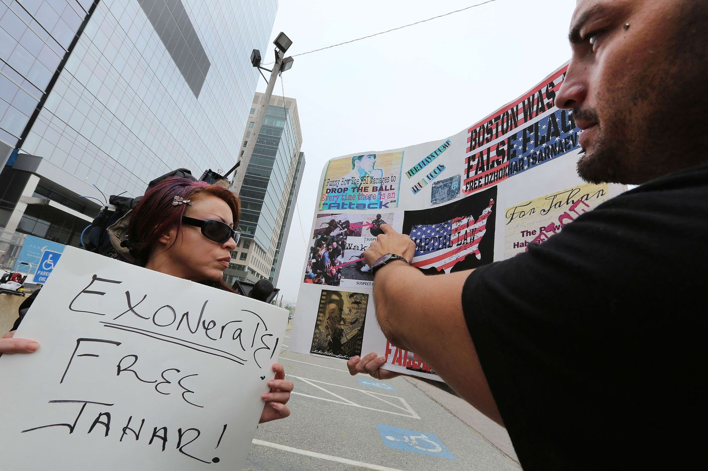 Karina Figueroa, left, of NYC, and Duke LaTouf of Las Vegas, believe in Tsarnaev's innocence.  Media and supporters of alleged Boston Marathon bombing suspect Dzhokhar Tsarnaev gather outside the John Joseph Moakley United States Courthouse on July 10, 2013, before the 19-year-old is charged.