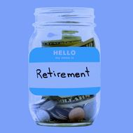 Retirement Savings Jar Of Coins And Banknotes