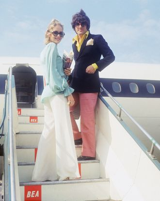 Jet-setters getting aboard a plane — the Strategist reviews the best travel pants for women.