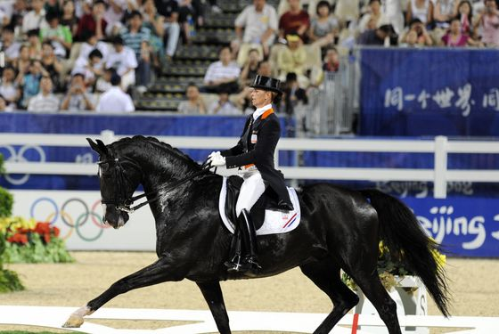 "Dutch Anky van Grunsven rides with ""Salinero"" in the Dressage Grand Prix on August 14, 2008 in Hong Kong. 47 Riders compete in the Dressage individual. AFP PHOTO/DDP/DAVID HECKER  (Photo credit should read DAVID HECKER/AFP/Getty Images)"