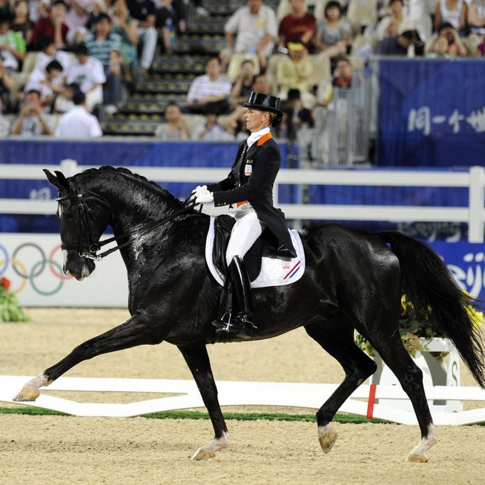 Dutch Anky van Grunsven rides with
