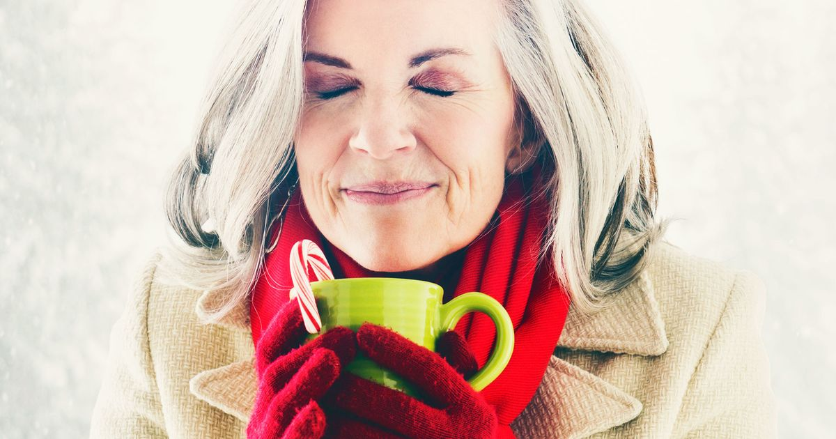 Caucasian woman drinking hot chocolate outdoors