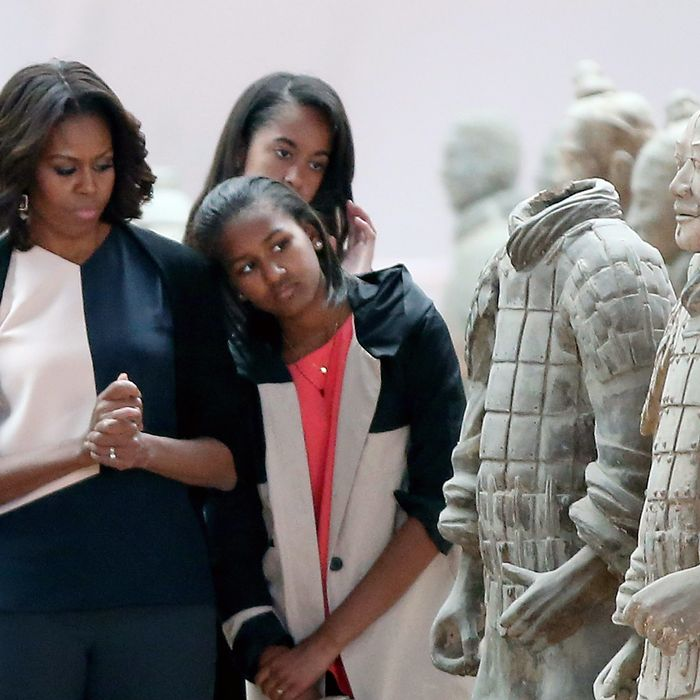 XI'AN, CHINA - MARCH 24: First Lady Michelle Obama with her daughters Malia Obama and Sasha Obama visit Museum of Terracotta Warriors during a visit to the historic excavation site on March 24, 2014 in Xi'an, China. Michelle Obama's one-week-long visit in China will be focused on educational and cultural exchanges. (Photo by Feng Li/Getty Images)