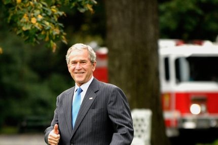 U.S. President George W. Bush gives the thumbs up sign as he departs the White House in Washington, D.C., U.S., on Friday, Oct. 17, 2008. Bush is spending the weekend at Camp David, Maryland, where he is scheduled to meet tomorrow with French President Nicolas Sarkozy and European Commission President Jose Barroso.