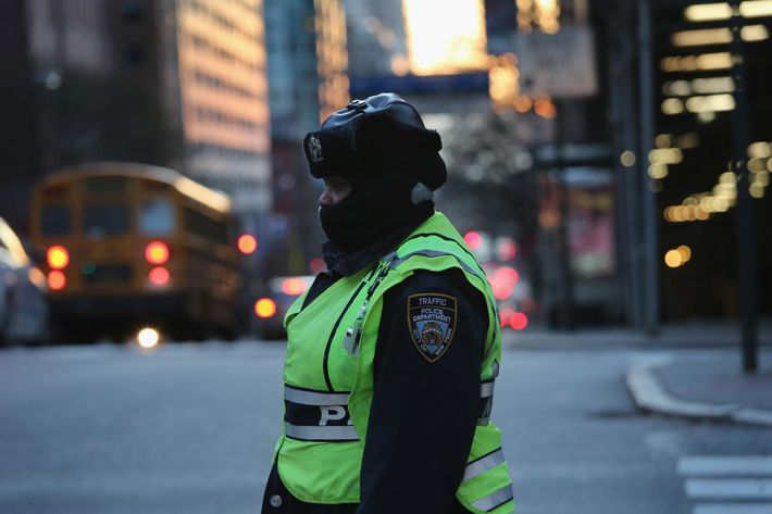 NEW YORK, NY - JANUARY 07:  A traffic police officer stands along Manhattan's Park Avenue on January 7, 2014 in New York City. A 'polar vortex'  of frigid air centered on the North Pole dropped temperatures to a record low 4 degrees in New York City.  (Photo by John Moore/Getty Images)