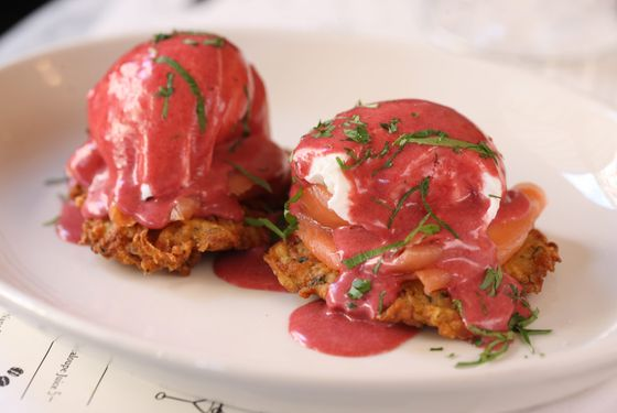 Eggs Benny: two poached eggs over potato latkes with smoked salmon and beet hollandaise.