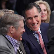 Former Republican presidential candidate Mitt Romney, center, joined by wife Ann, right, talks with an unidentified spectator at ringside prior to a welterweight fight between Juan Manuel Marquez and Manny Pacquiao title fight Saturday, Dec. 8, 2012, in Las Vegas. (AP Photo/Julie Jacobson)