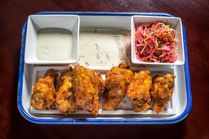 Thai chili chicken wings with blue cheese chili dressing.