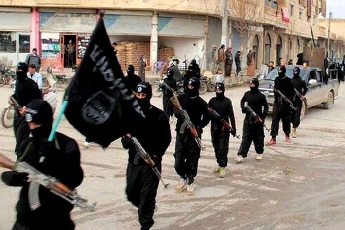 Undated image posted on a militant website on Tuesday, Jan. 14, 2014, showing fighters from ISIS marching in Raqqa, Syria.