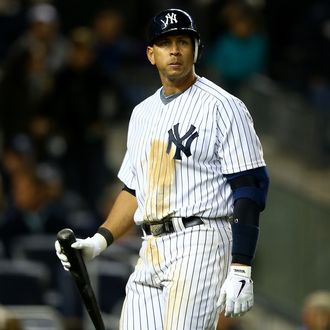 Alex Rodriguez #13 of the New York Yankees walks back to the dugout as he reacts to striking out in the bottom of the sixth inning against the Detroit Tigers during Game One of the American League Championship Series at Yankee Stadium on October 13, 2012 in the Bronx borough of New York City, New York.