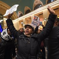 Protestors gather in New York Grand Central Station on December 3, 2014 after a grand jury decided not to charge a white police officer in the choking death of Eric Garner, a black man, days after a similar decision sparked renewed unrest in Missouri. Eric Garner died after being placed in a chokehold by New York police Officer Daniel Pantaleo while being arrested on suspicion of selling untaxed cigarettes in Staten Island.